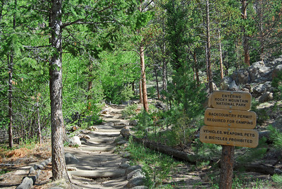 The trail goes through some private property at first, but eventually (quarter of a mile or more) you enter the park.