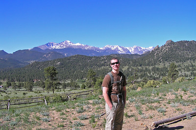 "Here is Will standing on a slight rise on what used to be a parking spot for the ""old"" trailhead.  It is no longer used.  Behind him is the bottom of the Black Canyon which is occupied by the MacGregor Ranch (which at one time I thought was being purchased by RMNP, but it appears that fell through; or something happened)."
