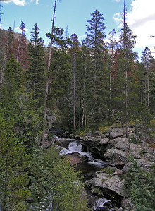 Here is a photo above Cascade Falls showing some nice, if small, waterfalls. Note that Cascade Falls is approximately a 3.5 mile (one way) hike.  So, 7 miles round trip.  Nothing for teenagers (except boredom : ), but a little long for younger children under 9 years of age (obviously, it all depends on the child in question).  There are places along the trail where you should watch that younger children don't get too close to the edge.  No extreme cliffs, but definitely some high places.  The reason that I don't have a photo of Cascade Falls is because, from what I could see, there is only one really nice place to view the Falls from and it was occupied by some other people.  My plan was to stop on the way back down and take a photo.  Little did I know : )