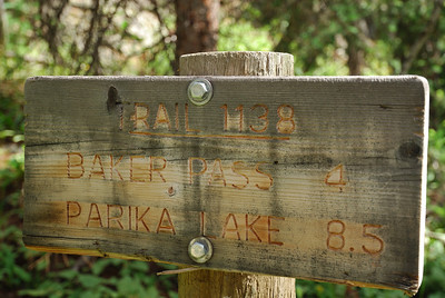 Checked out the various signs including how far it was to Baker Pass.  Gee.  Only 4 miles?  Piece of cake.  Mind you, that would mean a 11 mile round trip counting the road section I had to walk.  But still, noooooooooooooo problem.