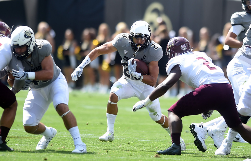 . Phillip Lindsay, of CU, looks for the opening during the game with Texas State on Saturday. For more photos, go to buffzone.com.  Cliff Grassmick / Staff Photographer/ September 9, 2017