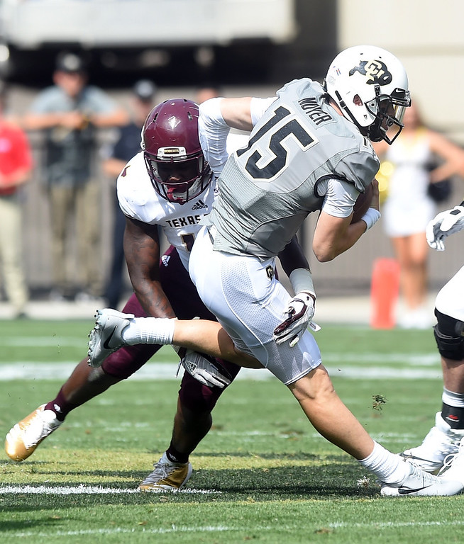 . Sam Noyer, of CU, tries to get away from the Texas State defender during the game with Texas State on Saturday. For more photos, go to buffzone.com.  Cliff Grassmick / Staff Photographer/ September 9, 2017
