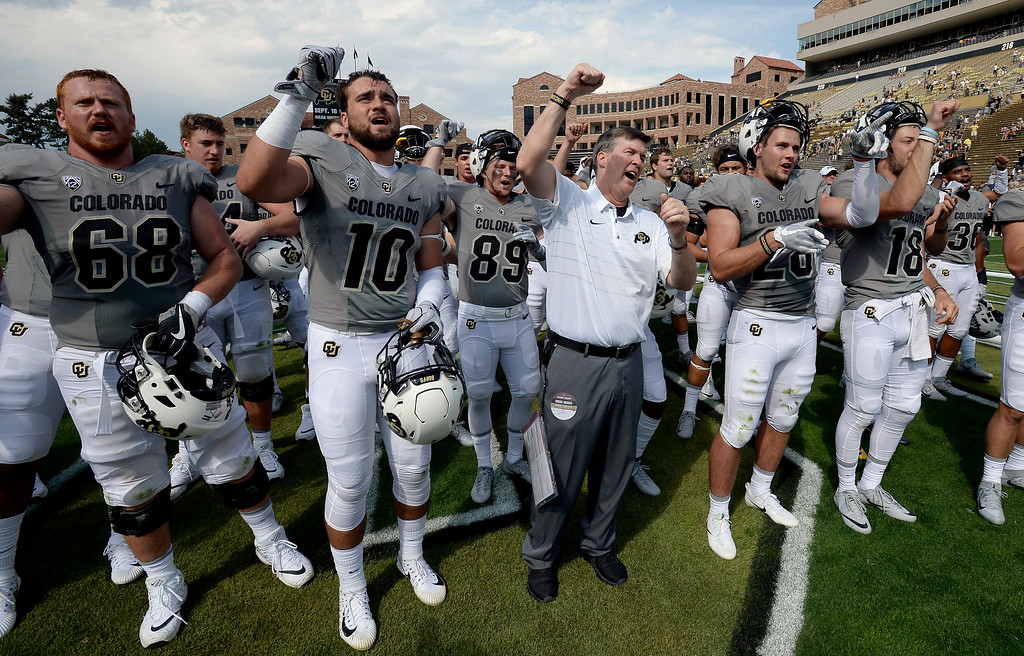 . CU coach Mike MacIntyre and signs the fight song with players after the win over  Texas State on Saturday. For more photos, go to buffzone.com.  Cliff Grassmick / Staff Photographer/ September 9, 2017