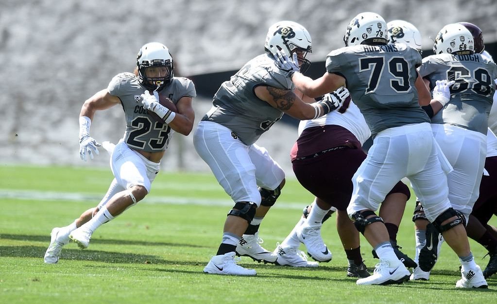 . Phillip Lindsay, of CU, runs around his O-line during the game with Texas State on Saturday. For more photos, go to buffzone.com.  Cliff Grassmick / Staff Photographer/ September 9, 2017