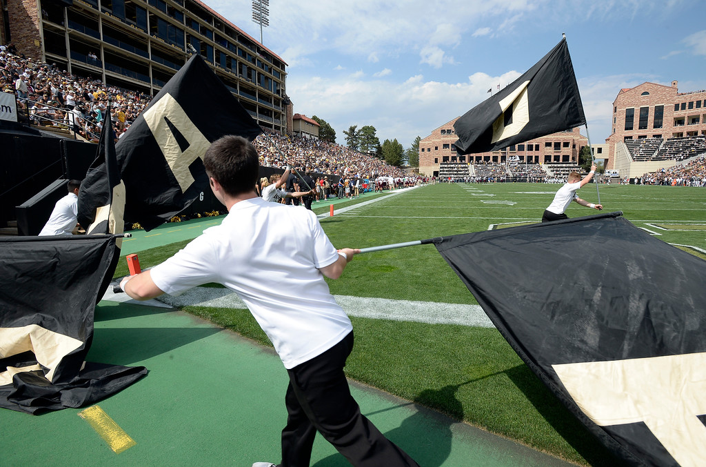 . Colorado flags celebrate a CU score during the game with Texas State on Saturday. For more photos, go to buffzone.com.  Cliff Grassmick / Staff Photographer/ September 9, 2017