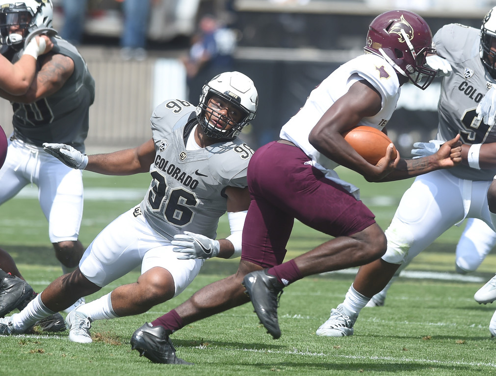 . Terran Hasselbach, of CU, pressures Willie Jones III, of Texas State, during the game with Texas State on Saturday. For more photos, go to buffzone.com.  Cliff Grassmick / Staff Photographer/ September 9, 2017
