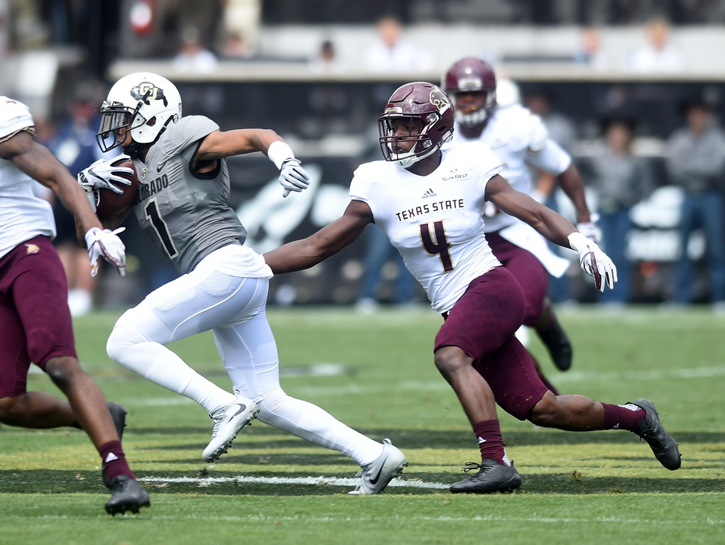 . Shay Fields, of CU, tries to escape Quinn Tiggs, of TSU, during the game with Texas State on Saturday. For more photos, go to buffzone.com.  Cliff Grassmick / Staff Photographer/ September 9, 2017