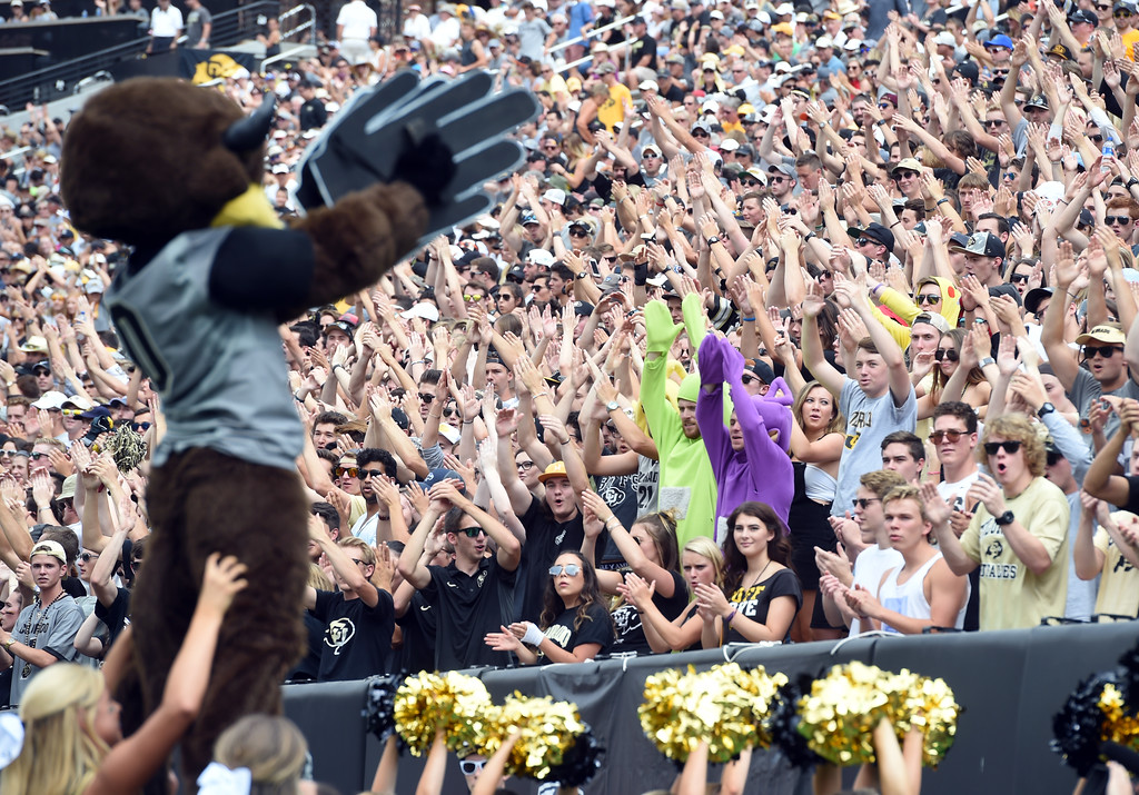 . Chip leads the CU student section in the clap cheer during the game with Texas State on Saturday. For more photos, go to buffzone.com.  Cliff Grassmick / Staff Photographer/ September 9, 2017