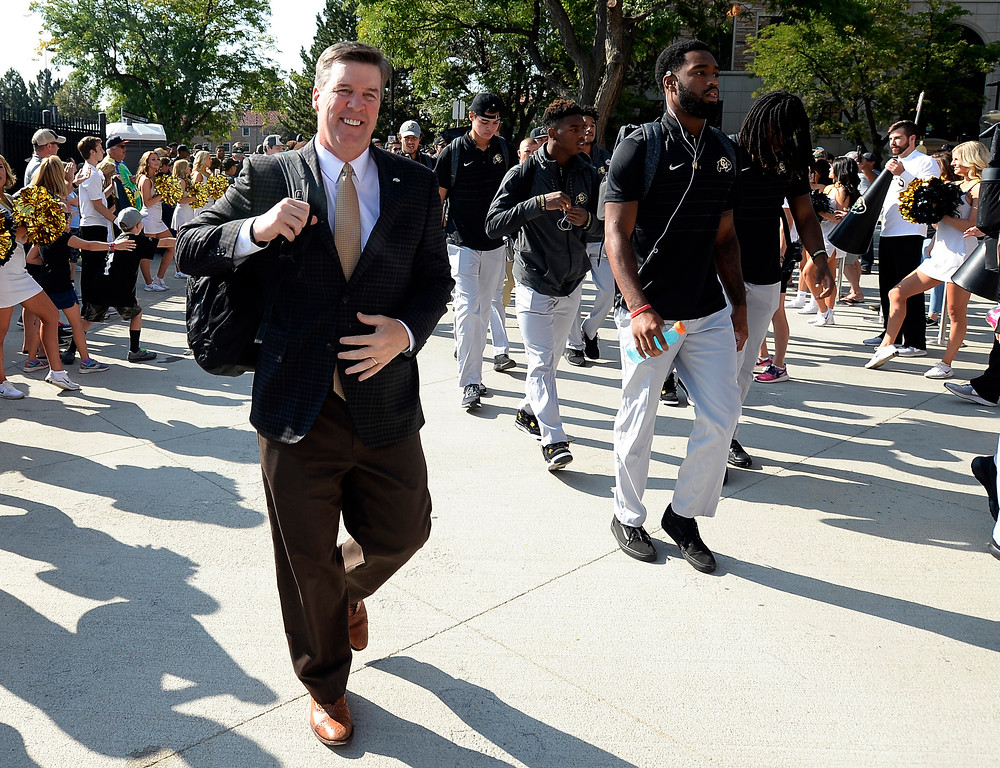 . Head football coach, Mike MacIntyre, arrives on the Buff Walk before the game with Texas State on Saturday. For more photos, go to buffzone.com.  Cliff Grassmick / Staff Photographer/ September 9, 2017