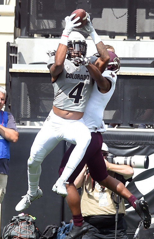 . Bryce Bobo, of CU, catches a TD pass during the game with Texas State on Saturday. For more photos, go to buffzone.com.  Cliff Grassmick / Staff Photographer/ September 9, 2017
