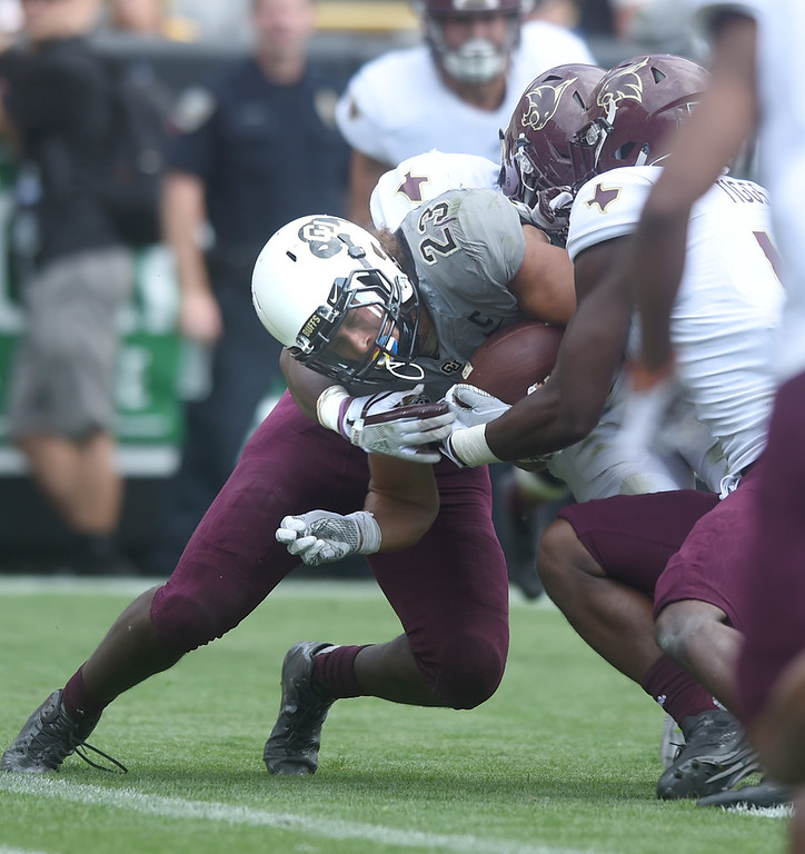 . Phillip Lindsay, of CU, drags Texas State defenders into the endzone during the game with Texas State on Saturday. For more photos, go to buffzone.com.  Cliff Grassmick / Staff Photographer/ September 9, 2017