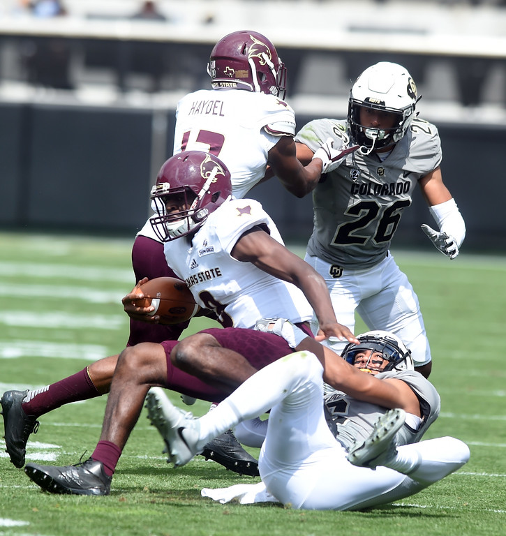. Evan Worthington, of CU, tackles Willie Jones, III, of TSU, during the game with Texas State on Saturday. For more photos, go to buffzone.com.  Cliff Grassmick / Staff Photographer/ September 9, 2017