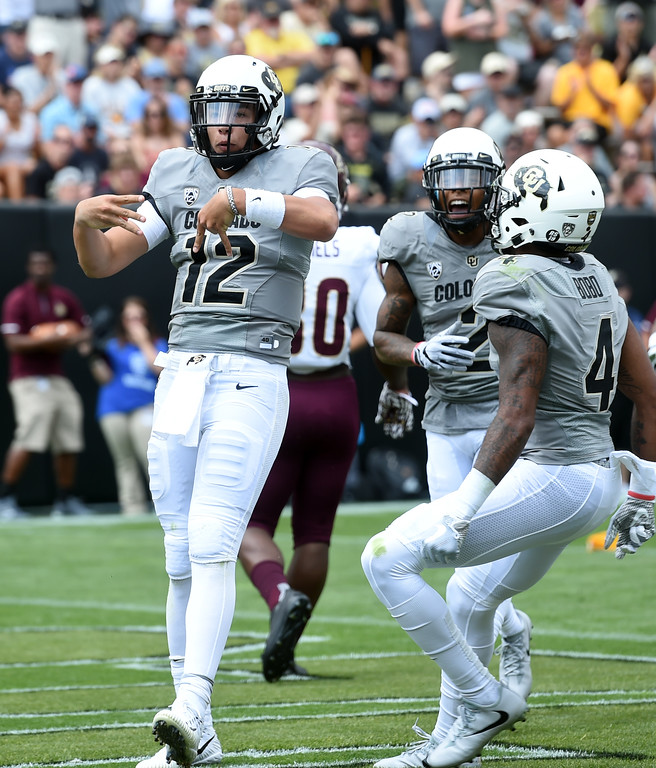 . Steven Montez, of CU celebrates his TD run during the game with Texas State on Saturday. For more photos, go to buffzone.com.  Cliff Grassmick / Staff Photographer/ September 9, 2017