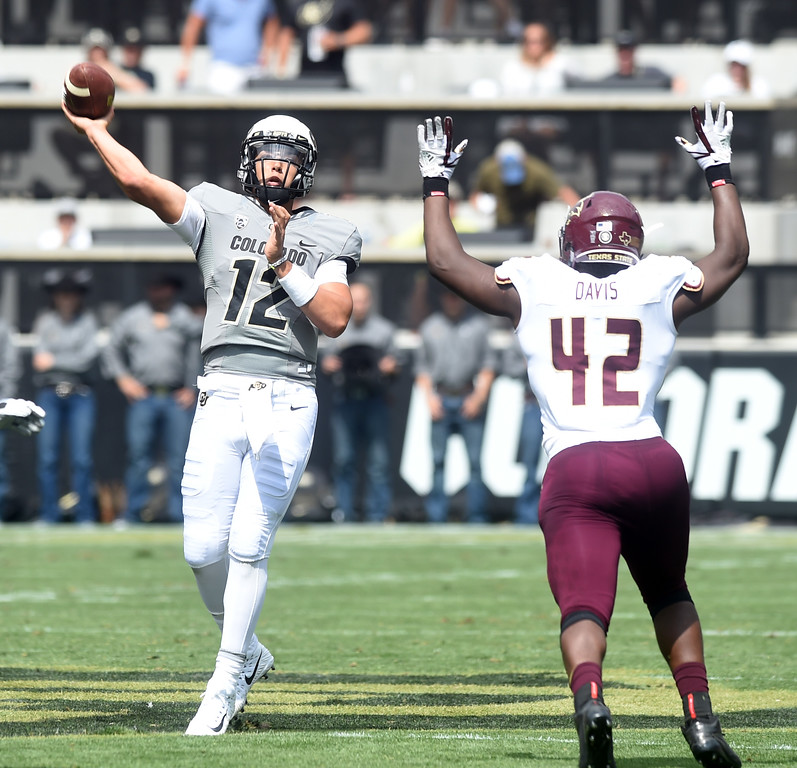 . Steven Montez, of CU, airs it out during the game with Texas State on Saturday. For more photos, go to buffzone.com.  Cliff Grassmick / Staff Photographer/ September 9, 2017