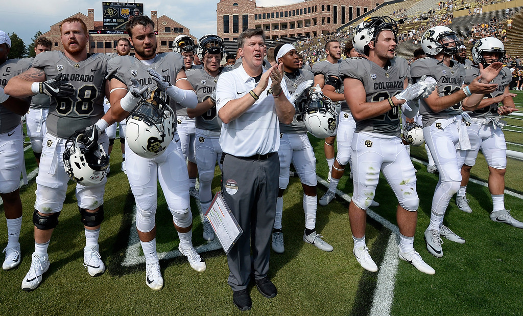 . CU Head Coach, Mike MacIntyre, sings the CU fight song with his players after the win over Texas State on Saturday. For more photos, go to buffzone.com.  Cliff Grassmick / Staff Photographer/ September 9, 2017