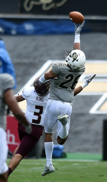 . Isaiah Oliver, of CU, makes an interception over Elijah King, of TSU, during the game with Texas State on Saturday. For more photos, go to buffzone.com.  Cliff Grassmick / Staff Photographer/ September 9, 2017