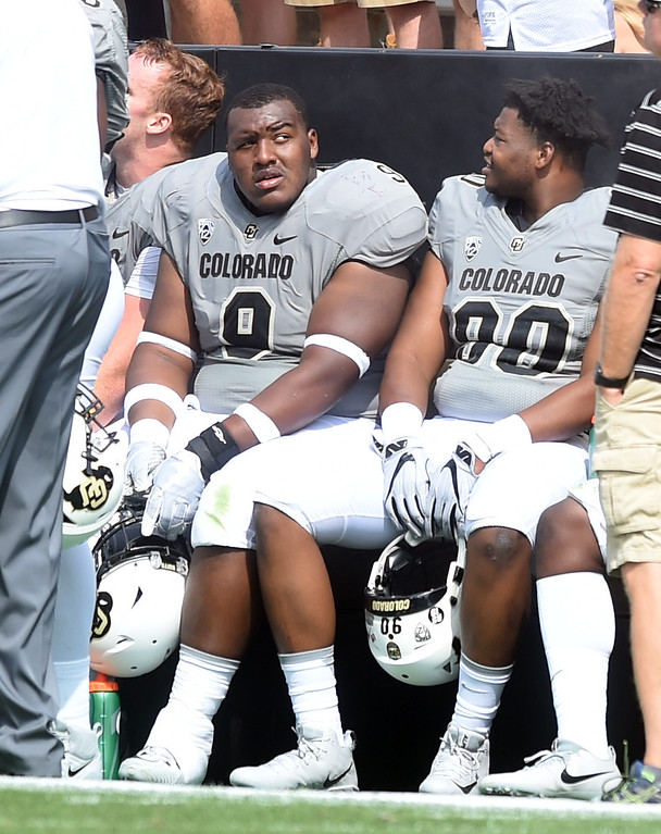 . CU DT, Javier Edwards, left, during the game with Texas State on Saturday. For more photos, go to buffzone.com.  Cliff Grassmick / Staff Photographer/ September 9, 2017