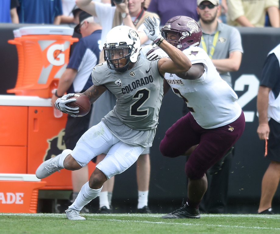 . Devin Ross, of CU, makes moves on Gabe Loyd, of TSU, during the game with Texas State on Saturday. For more photos, go to buffzone.com.  Cliff Grassmick / Staff Photographer/ September 9, 2017