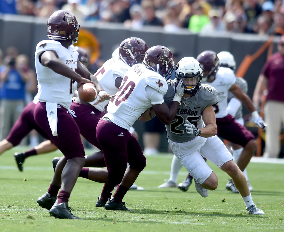 . Ryan Moeller, of CU, rushes the Texas State QB during the game with Texas State on Saturday. For more photos, go to buffzone.com.  Cliff Grassmick / Staff Photographer/ September 9, 2017