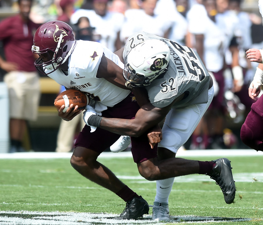 . Leo Jackson III, of CU, sacks Willie Jones III, of Texas State, during the game with Texas State on Saturday. For more photos, go to buffzone.com.  Cliff Grassmick / Staff Photographer/ September 9, 2017