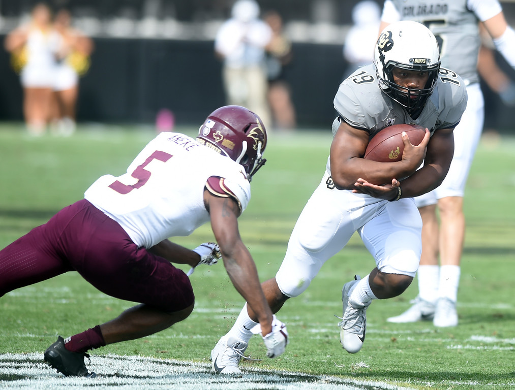. Michael Adkis II, of CU, prepares for the hit by Andrew Aneke, of TSU, during the game with Texas State on Saturday. For more photos, go to buffzone.com.  Cliff Grassmick / Staff Photographer/ September 9, 2017