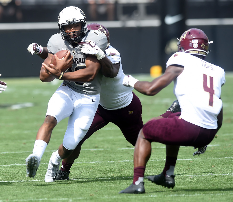 . Michael Adkis II, of CU, prepares for the hit by Quinn Tiggs of TSU, during the game with Texas State on Saturday. For more photos, go to buffzone.com.  Cliff Grassmick / Staff Photographer/ September 9, 2017