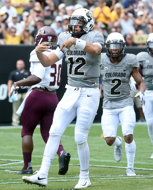 . CU QB, Steven Montez, celebrates his TD run during the game with Texas State on Saturday. For more photos, go to buffzone.com.  Cliff Grassmick / Staff Photographer/ September 9, 2017