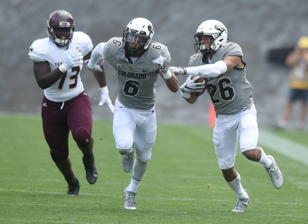 . Isaiah Oliver, of CU, runs back an interception during the game with Texas State on Saturday. For more photos, go to buffzone.com.  Cliff Grassmick / Staff Photographer/ September 9, 2017