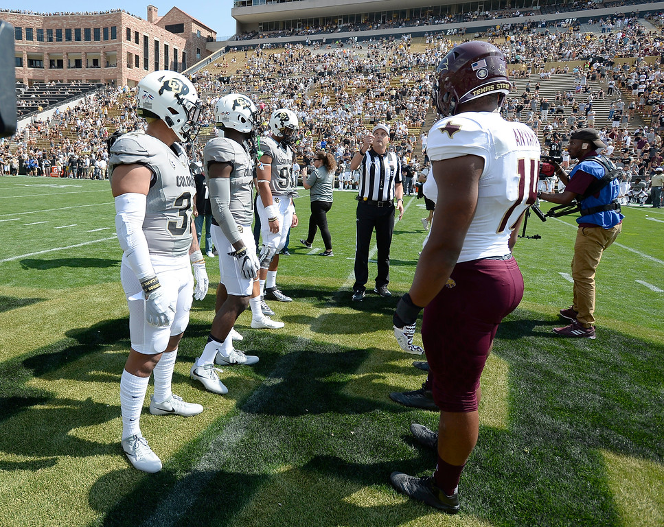 . Colorado and Texas State at the coin toss before  the game with Texas State on Saturday. For more photos, go to buffzone.com.  Cliff Grassmick / Staff Photographer/ September 9, 2017