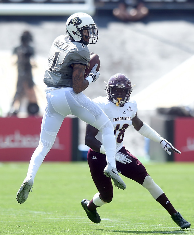 . Shay Fields, of CU, makes a catch in front of Frankie Griffin, of TSU, during the game with Texas State on Saturday. For more photos, go to buffzone.com.  Cliff Grassmick / Staff Photographer/ September 9, 2017