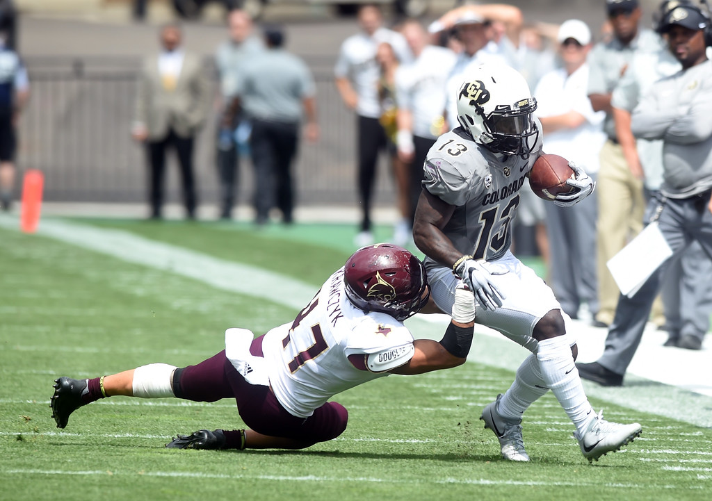 . KD Nixon, of CU, takes off with a pass during the game with Texas State on Saturday. For more photos, go to buffzone.com.  Cliff Grassmick / Staff Photographer/ September 9, 2017