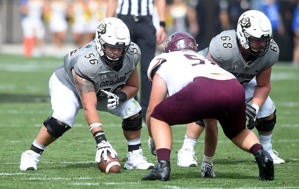 . Tim Lynott, Jr, plays center, and Gerrad Kough, on the CU offensive line during the game with Texas State on Saturday. For more photos, go to buffzone.com.  Cliff Grassmick / Staff Photographer/ September 9, 2017