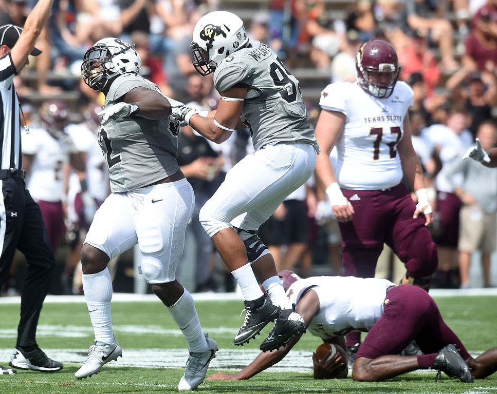 . Leo Jackson III, of CU, and Derek McCartney, celebrate a sack on Willie Jones III, of TSU, during the game with Texas State on Saturday. For more photos, go to buffzone.com.  Cliff Grassmick / Staff Photographer/ September 9, 2017