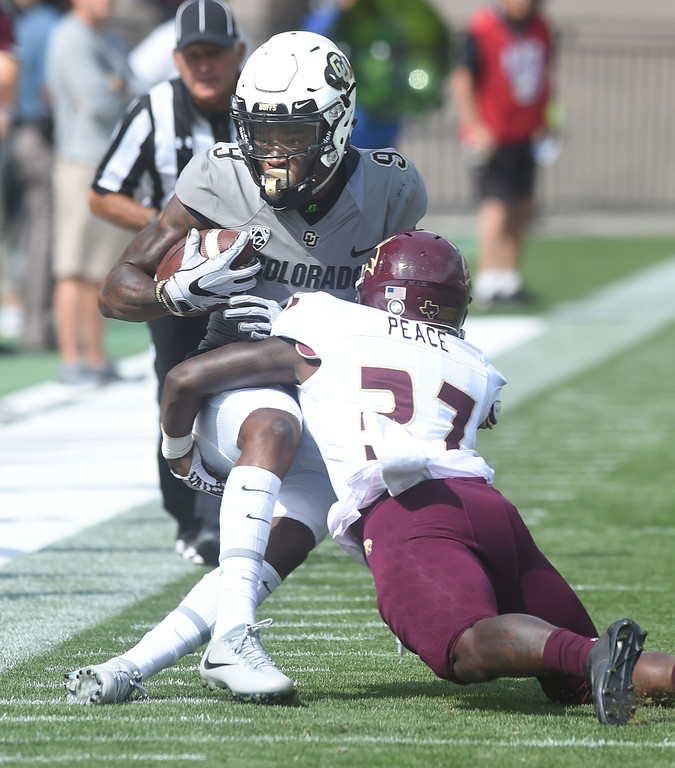 . Juwann Winfree, of CU, is tackled by Greg Peace II, of Texas State, during the game with Texas State on Saturday. For more photos, go to buffzone.com.  Cliff Grassmick / Staff Photographer/ September 9, 2017