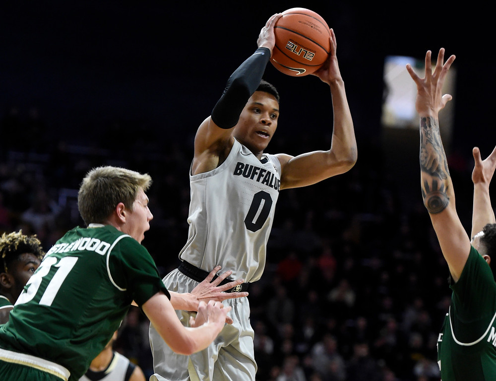 . BOULDER, CO: December 1:  Shane Gatling, of CU, passes to the outside during the Colorado and Colorado State men\'s basketball game. (Photo by Cliff Grassmick/Staff Photographer)