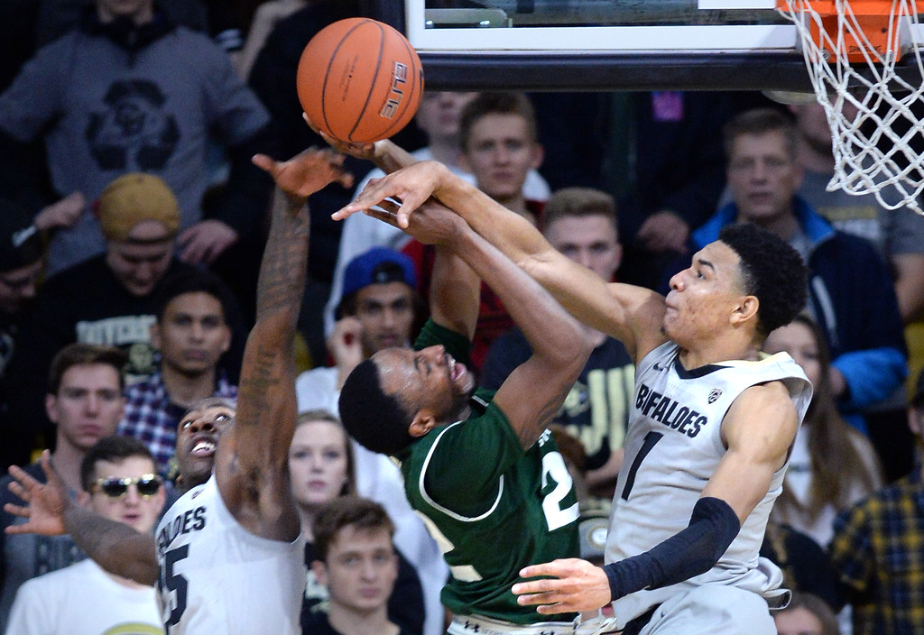 . BOULDER, CO: December 1:  JD Paige, of CSU, gets his shot blocked by Tyler Bey, of CU, during the Colorado and Colorado State men\'s basketball game. (Photo by Cliff Grassmick/Staff Photographer)