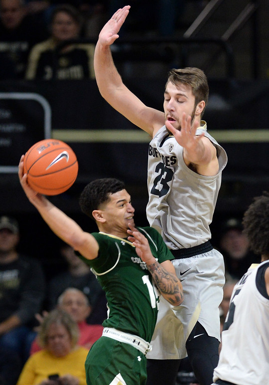 . BOULDER, CO: December 1:   Lucas Siewert, of CU, plays Anthony Masinton-Booner, of CSU, during the Colorado and Colorado State men\'s basketball game. (Photo by Cliff Grassmick/Staff Photographer)