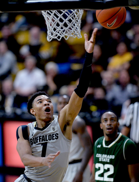. BOULDER, CO: December 1:  Tyler Bey, of CU, scores against CSU, during the Colorado and Colorado State men\'s basketball game. (Photo by Cliff Grassmick/Staff Photographer)