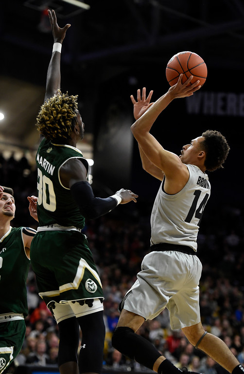 . BOULDER, CO: December 1: Deleon Brown, of CU, shoots over Kris Martin, of CSU,  during the Colorado and Colorado State men\'s basketball game. (Photo by Cliff Grassmick/Staff Photographer)
