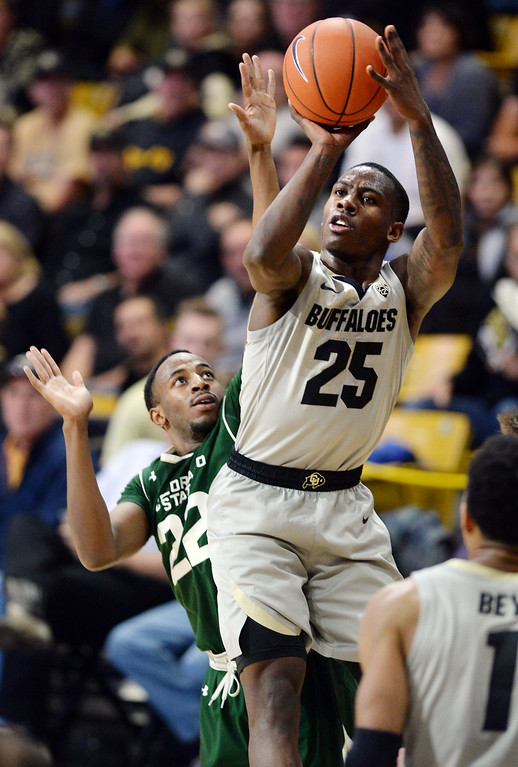 . BOULDER, CO: December 1:  McKinley Wright IV, of CU, gets past JD Paige, of CSU, during the Colorado and Colorado State men\'s basketball game. (Photo by Cliff Grassmick/Staff Photographer)