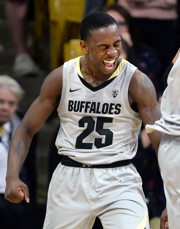 . BOULDER, CO: December 1:  McKInley Wright IV, of CU, celebrates the win over CSU during the Colorado and Colorado State men\'s basketball game. (Photo by Cliff Grassmick/Staff Photographer)