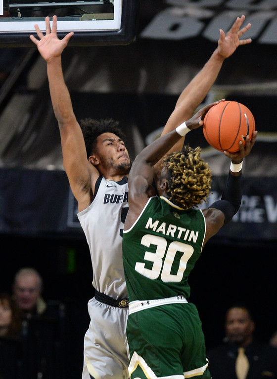 . BOULDER, CO: December 1: D\'Shawn Schwartz, of CU, plays defense on Kris Martin, of CSU,  during the Colorado and Colorado State men\'s basketball game. (Photo by Cliff Grassmick/Staff Photographer)
