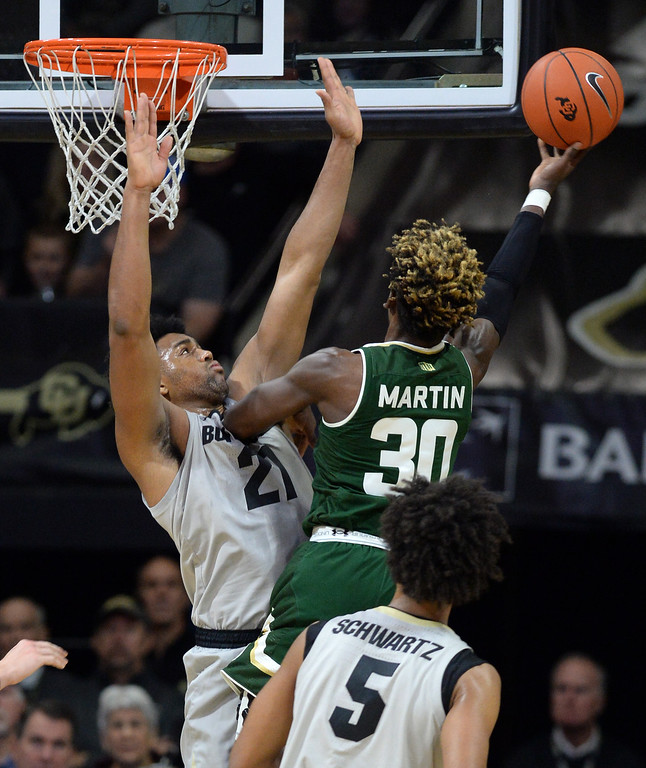 . BOULDER, CO: December 1: Kris Marin, of CSU, tries to score on Evan Battey, of CU,  during the Colorado and Colorado State men\'s basketball game. (Photo by Cliff Grassmick/Staff Photographer)