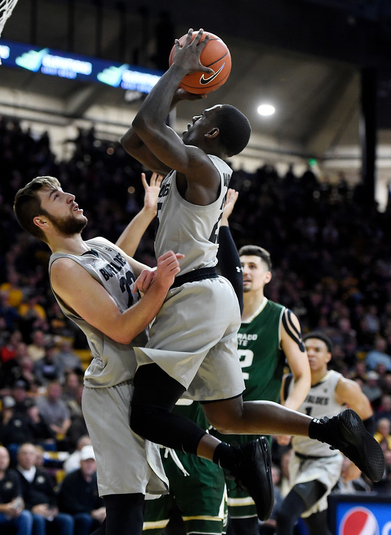 . BOULDER, CO: December 1:   McKinley Wright IV, of CU, drives to the basket against  CSU, during the Colorado and Colorado State men\'s basketball game. (Photo by Cliff Grassmick/Staff Photographer)