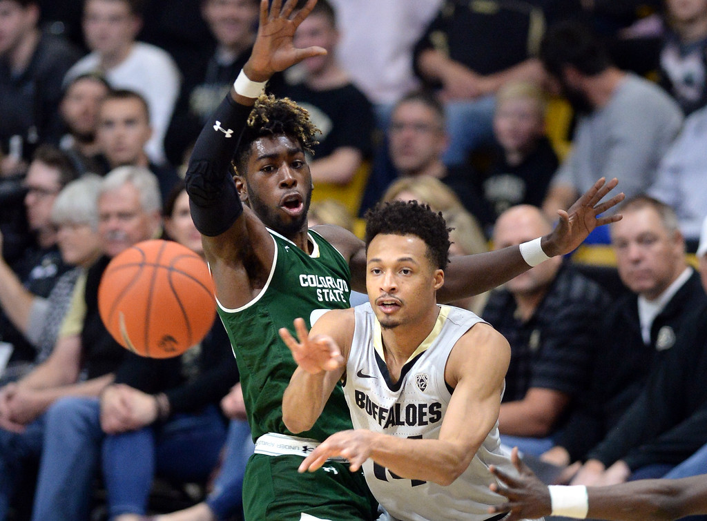 . BOULDER, CO: December 1: Deleon Brown, of CU, gets the pass away from Kris Martin, of CSU,  during the Colorado and Colorado State men\'s basketball game. (Photo by Cliff Grassmick/Staff Photographer)