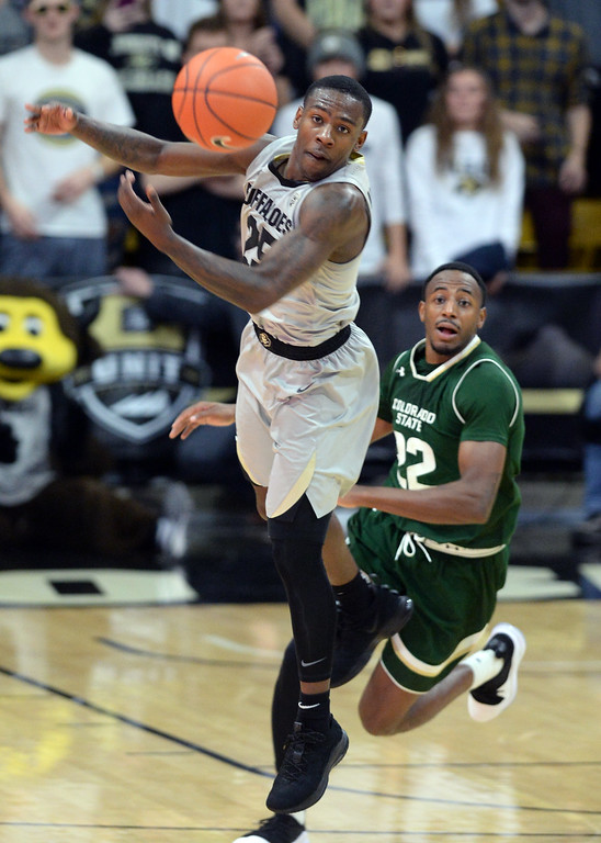 . BOULDER, CO: December 1:  The ball gets past McKInley Wright IV, of CU, and JD Paige, of CSU, during the Colorado and Colorado State men\'s basketball game. (Photo by Cliff Grassmick/Staff Photographer)