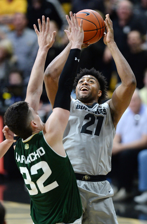 . BOULDER, CO: December 1:  Evan Battey, of CU shoots on Nico Carvacho, of CSU, during the Colorado and Colorado State men\'s basketball game. (Photo by Cliff Grassmick/Staff Photographer)