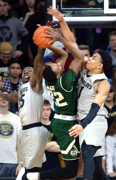 . BOULDER, CO: December 1:  JD Paige, of CSU, gets his shot blocked by  McLinley Wright IV, and Tyler Bey, of CU, during the Colorado and Colorado State men\'s basketball game. (Photo by Cliff Grassmick/Staff Photographer)