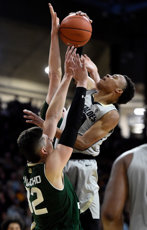 . BOULDER, CO: December 1:  Shane Gatling, of CU, runs into Nico Carvacho, of CSU, during the Colorado and Colorado State men\'s basketball game. (Photo by Cliff Grassmick/Staff Photographer)