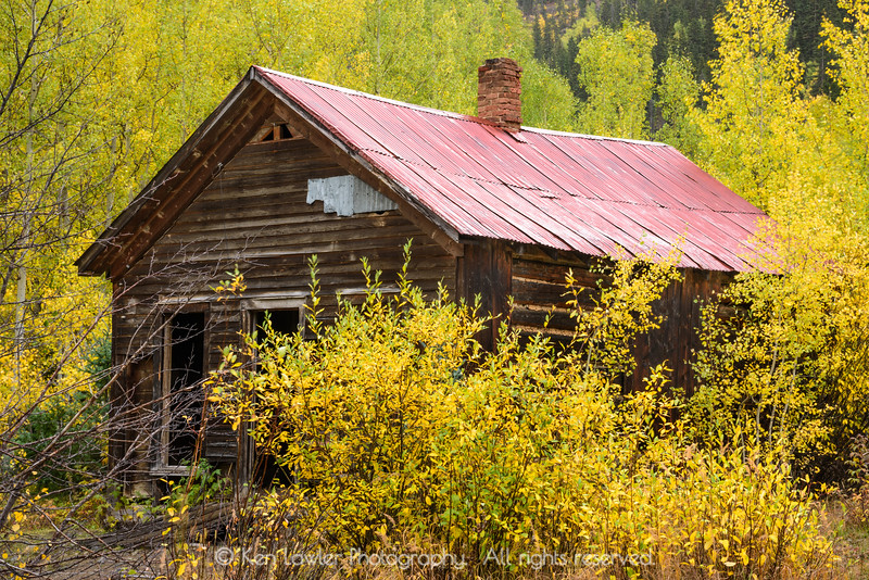Old mining house in aspens